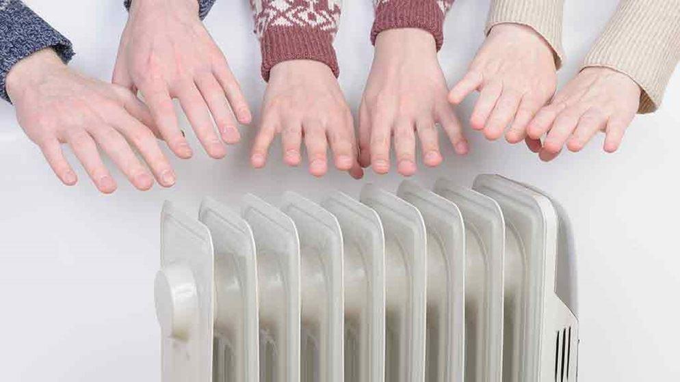 hands-held-over-column-heater